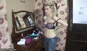 Ponytailed blonde shows her beautiful jugs for y ou