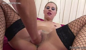 Fishnet-clad beauty getting fisted brutally