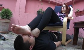 Big feet redhead using her pathetic slave as a foot stool
