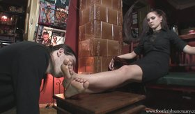 Seductive brunette in black lets her slave worship those feet