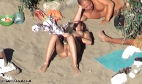 Frisky slut is showing off her perfectly shaved vagina on beach