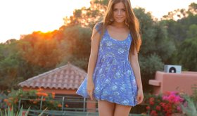 Young long hair teen is getting out off her gorgeous sun dress