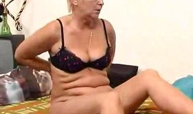 Mature porn scene with older bimbo getting horny