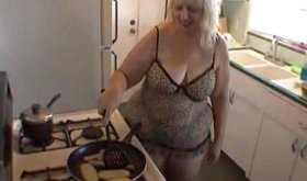 Obese exgf in sexy negligee preparing her meal