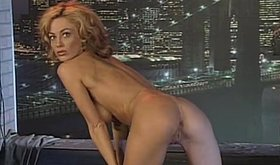 Blonde lady with perfect big tits seducing and stripping