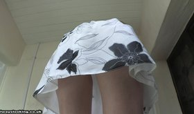 Leggy blonde giving you some awesome upskirt shots