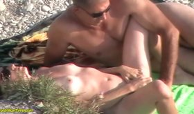 Blond-haired beauty masturbating on a public beach