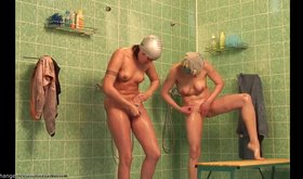 Impressive shower voyeur video featuring two slim chicks in HD