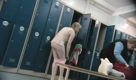Pale-skinned slim blonde shows her body in a locker room video