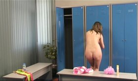 Slim chick with a hot nude body shows it all off in the locker room